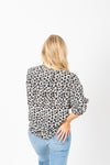 The Hara Floral Blouse in Black, studio shoot; back view