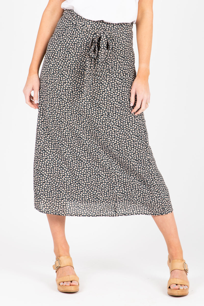 The Oswald Patterned Wrap Skirt in Black, studio shoot; front view