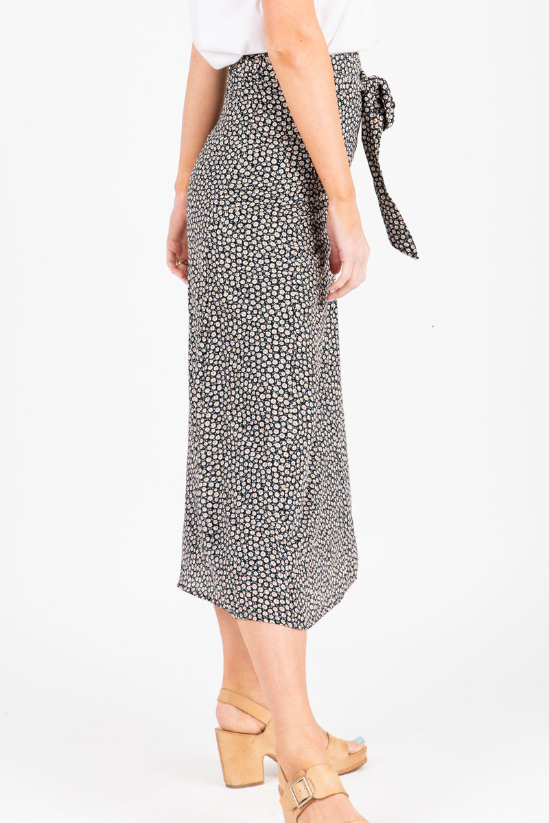 The Oswald Patterned Wrap Skirt in Black, studio shoot; side view