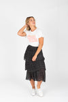 The Molly Tiny Dot Tiered Skirt in Black, studio shoot; front view