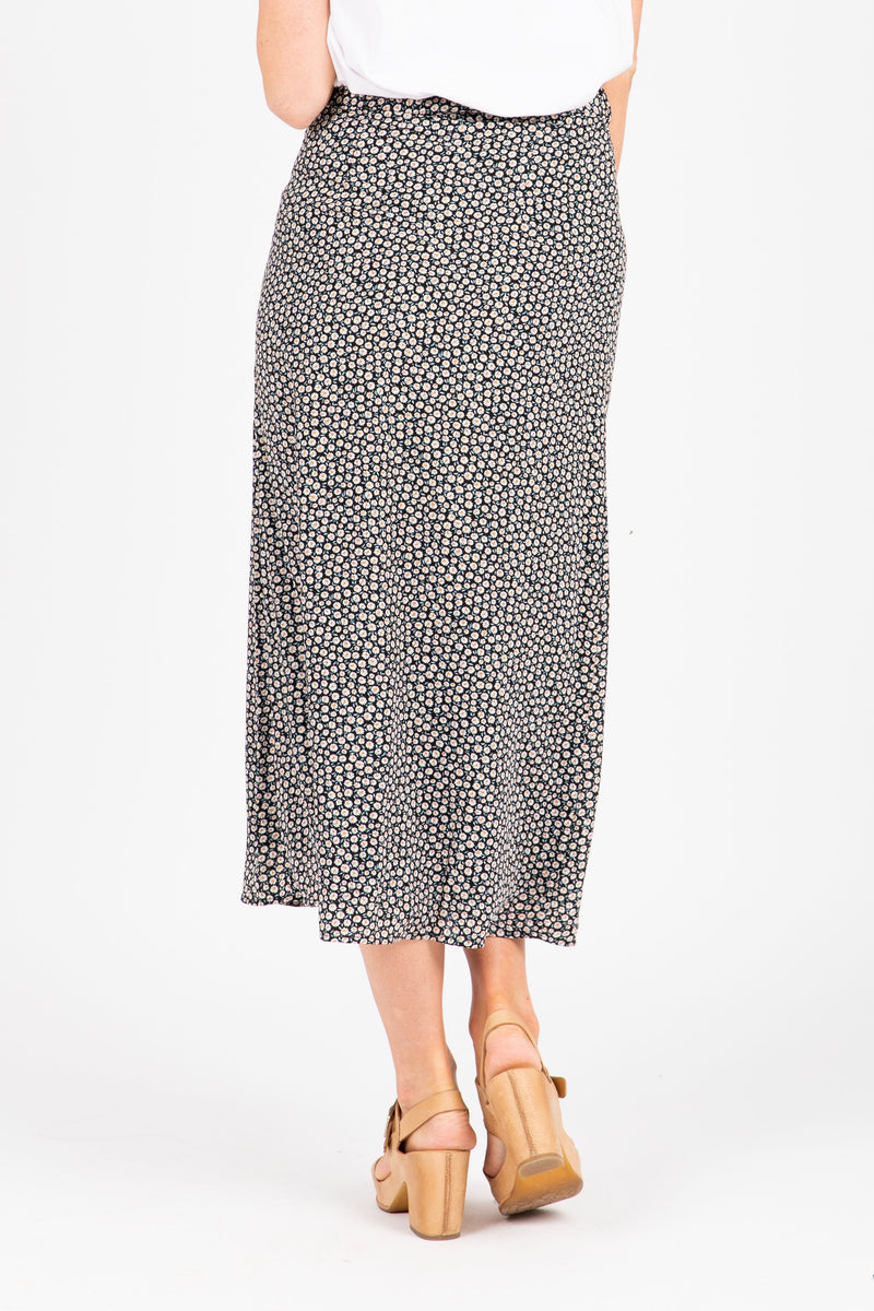 The Oswald Patterned Wrap Skirt in Black, studio shoot; back view