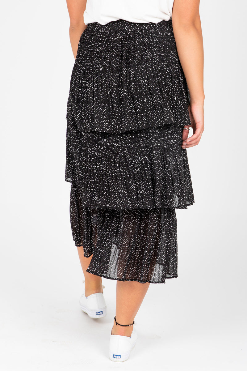 The Molly Tiny Dot Tiered Skirt in Black, studio shoot; back view