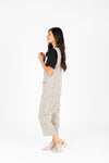 The Maxine Dot Button Jumpsuit in Cream, studio shoot; side view