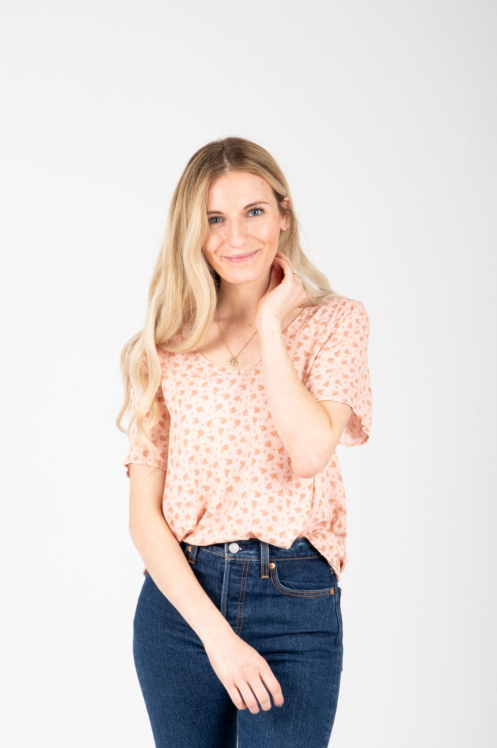 The Dayana Patterned Blouse in Peach, studio shoot; front view