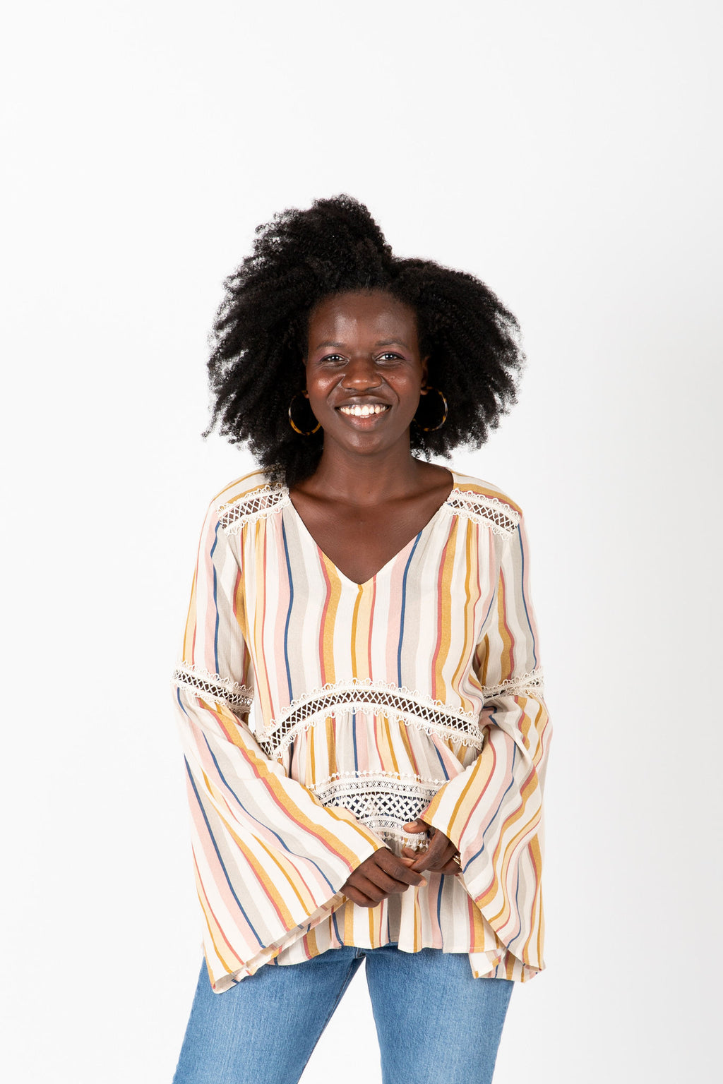The Phillips Striped Flare Blouse in Blush, studio shoot; front view