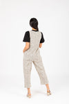 The Maxine Dot Button Jumpsuit in Cream, studio shoot; back view