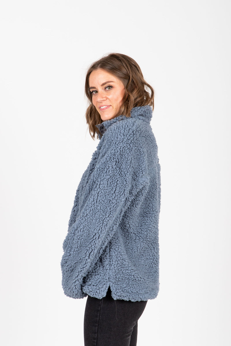 The Daydream Pullover in Ashley Blue + Heather Grey, studio shoot; side view