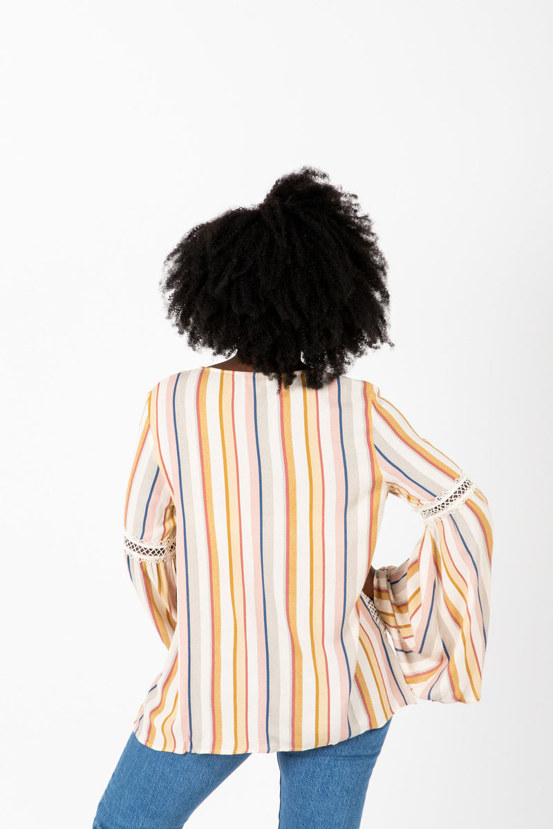 The Phillips Striped Flare Blouse in Blush, studio shoot; back view