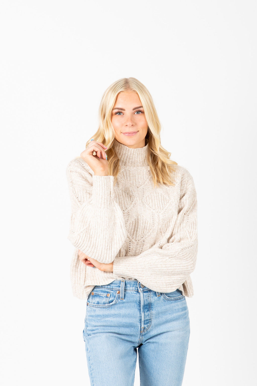 The Rivera Cable Knit Mock Neck in Oatmeal, studio shoot; front view