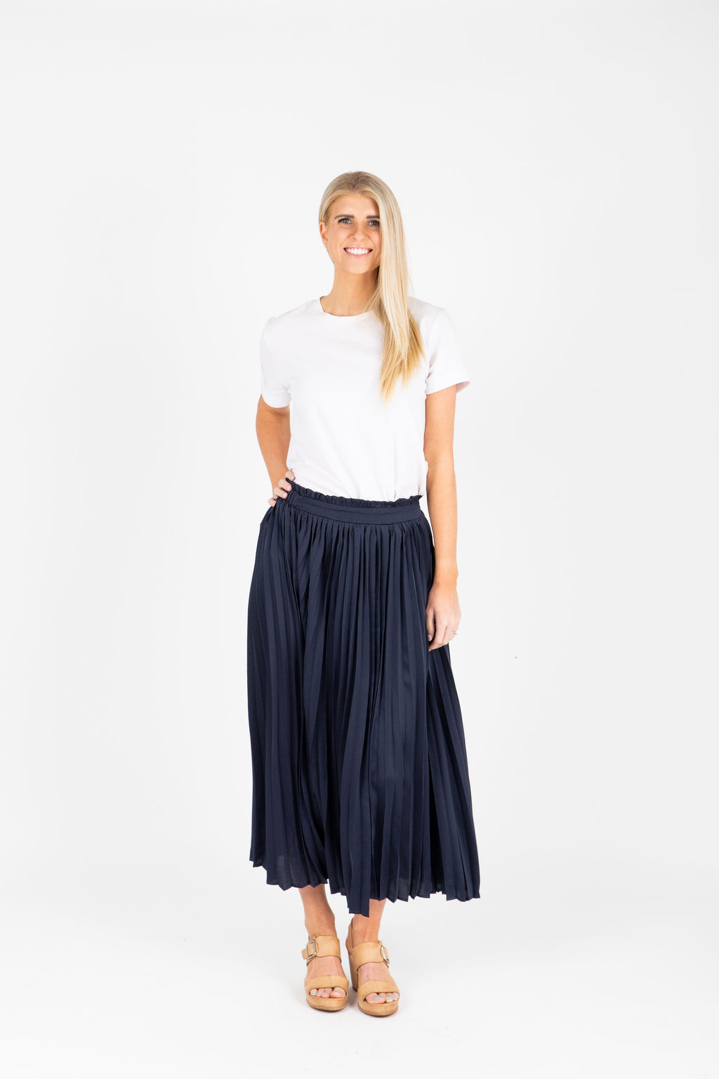 The Camilo Pleated Silk Skirt in Navy, studio shoot; front view