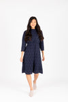 The Othello Lace Ruffle Dress in Navy, studio shoot; front view