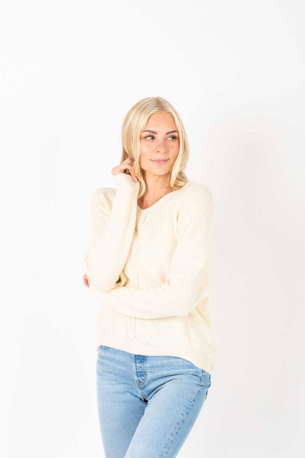 The Justina V-Neck Knit in Cream, studio shoot; front view