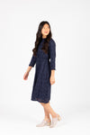 The Othello Lace Ruffle Dress in Navy, studio shoot; side view