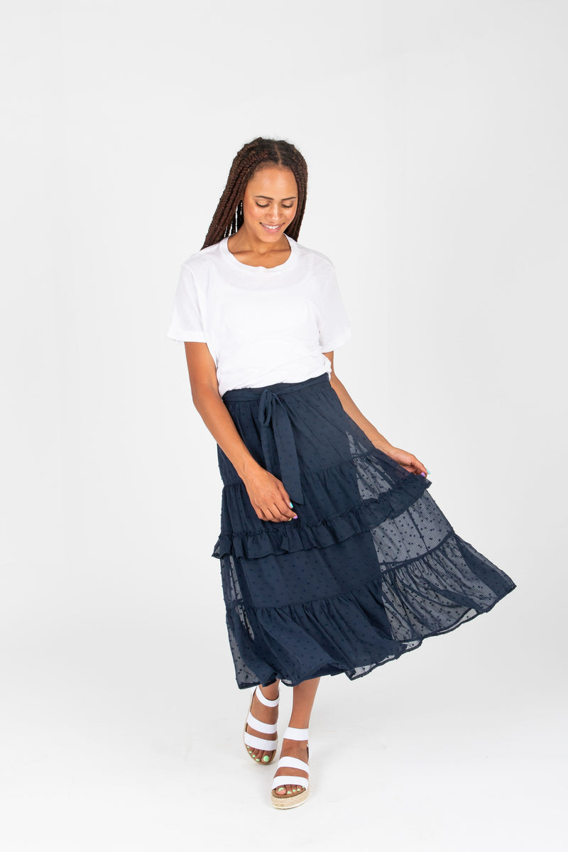 The Emersyn Swiss Dot Ruffle Skirt in Navy, studio shoot; front view