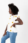 The Lanei Embroidered Daisy Blouse in White, studio shoot; side view