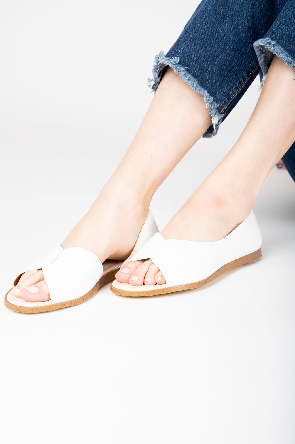 The Iris Petal Sandal in White, studio shoot; side view