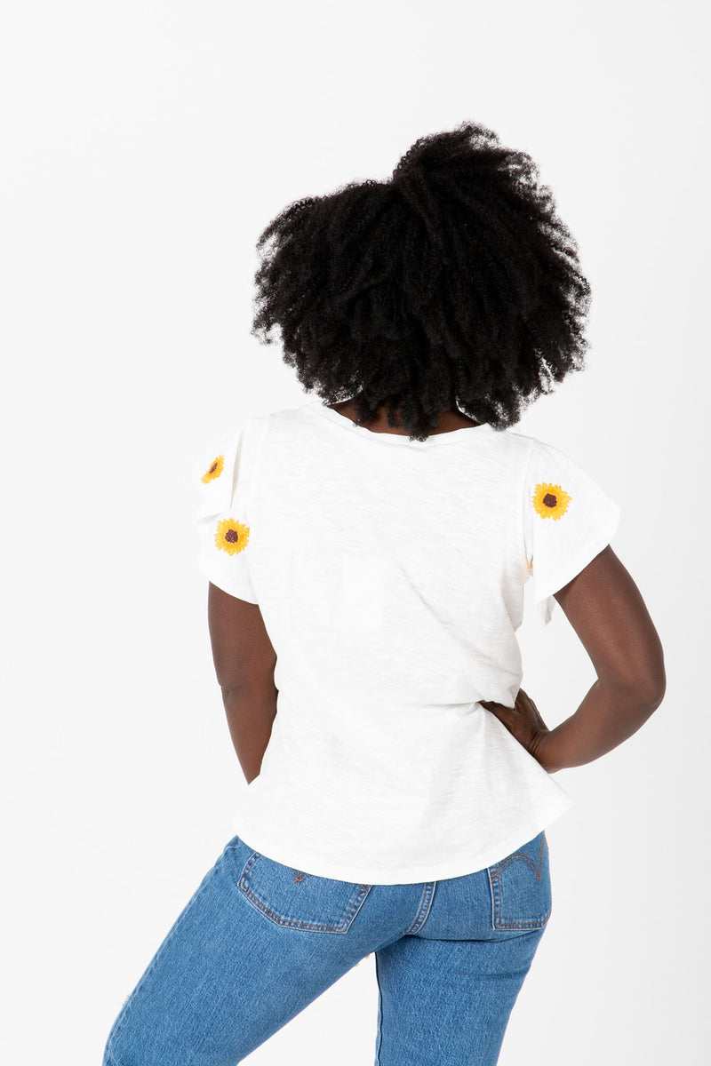 The Lanei Embroidered Daisy Blouse in White, studio shoot; back view