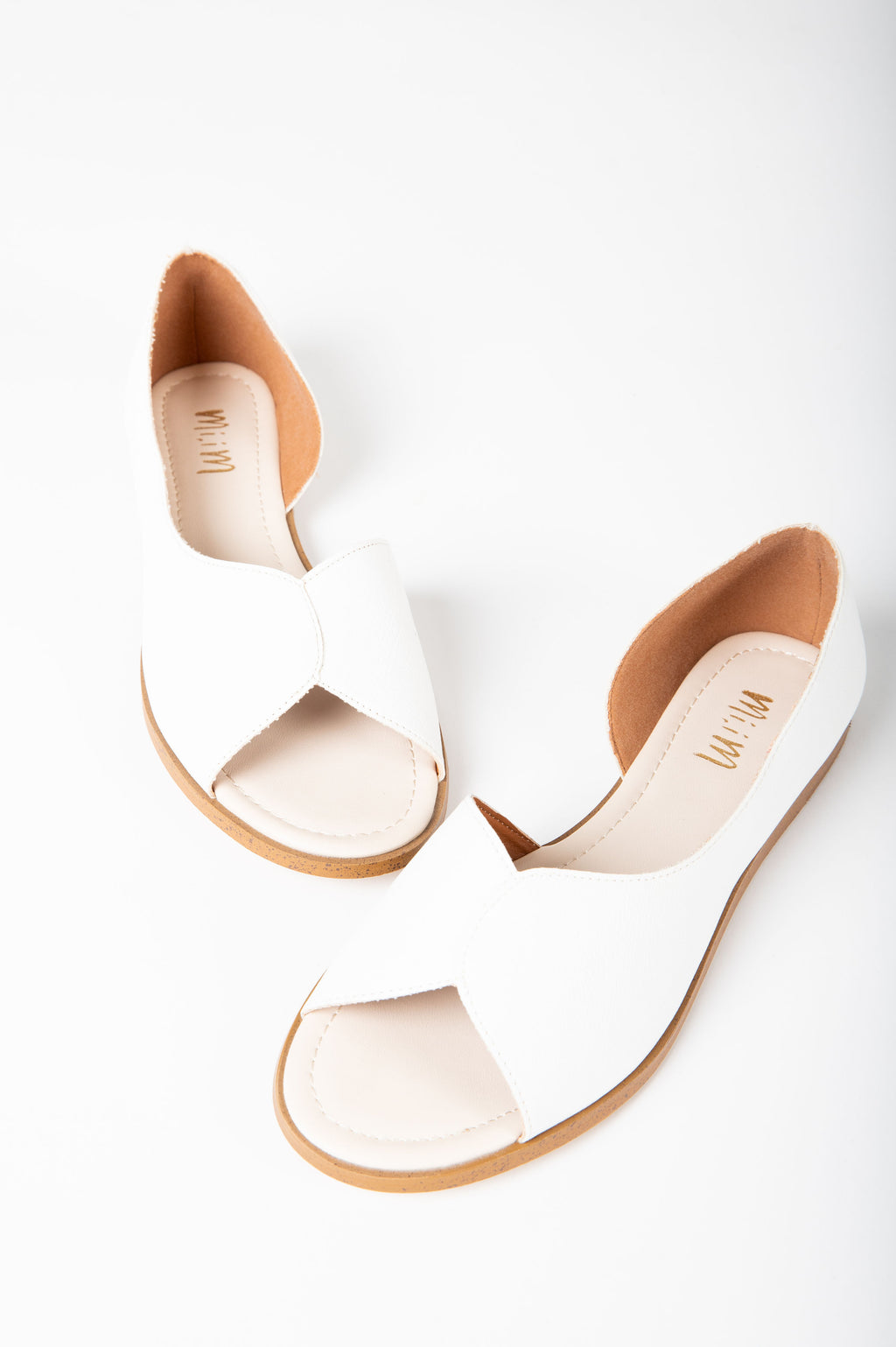 The Iris Petal Sandal in White, studio shoot; front view