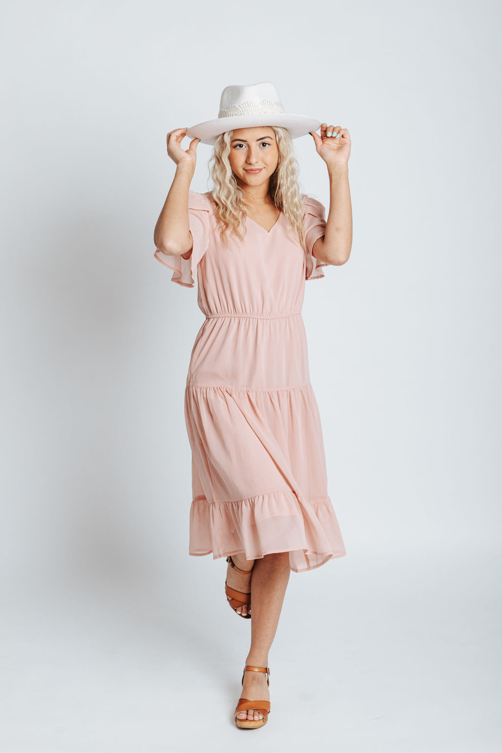 The Amara Ruffle Detail Dress in Blush, studio shoot; front view
