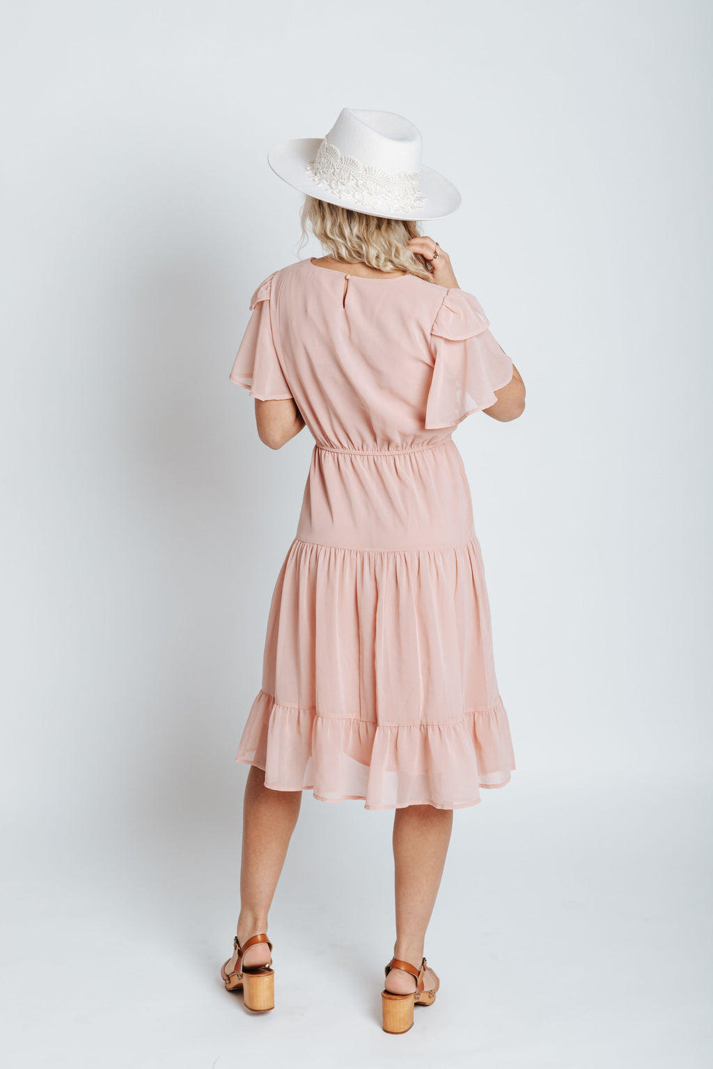 The Amara Ruffle Detail Dress in Blush, studio shoot; back view