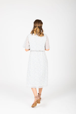 Piper & Scoot: The Reese Floral Tie Dress in White, studio shoot; back view