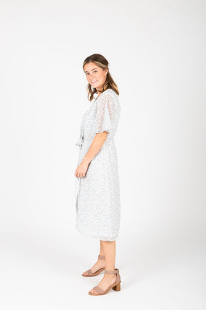 Piper & Scoot: The Reese Floral Tie Dress in White, studio shoot; side view