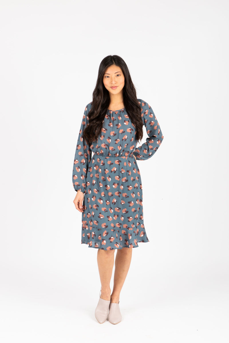The Dalila Floral Ruffle Dress in Dusty Blue, studio shoot; front view