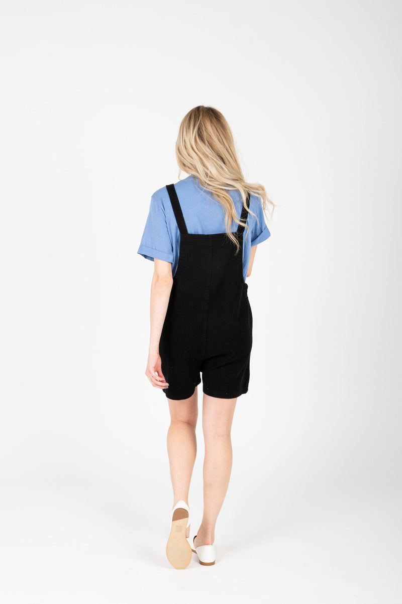 The Mina Shortie Overalls in Black, studio shoot; back view