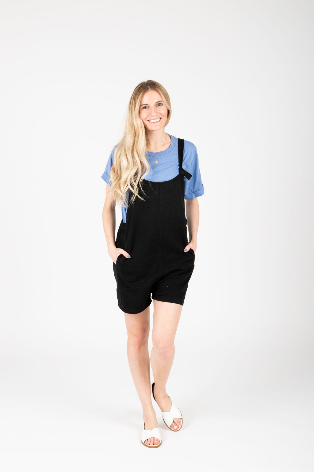 The Mina Shortie Overalls in Black, studio shoot; front view
