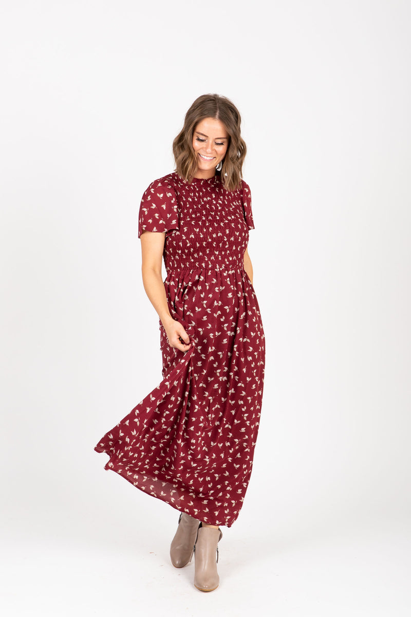 The Gibson Floral Smocked Dress in Burgundy, studio shoot; front view