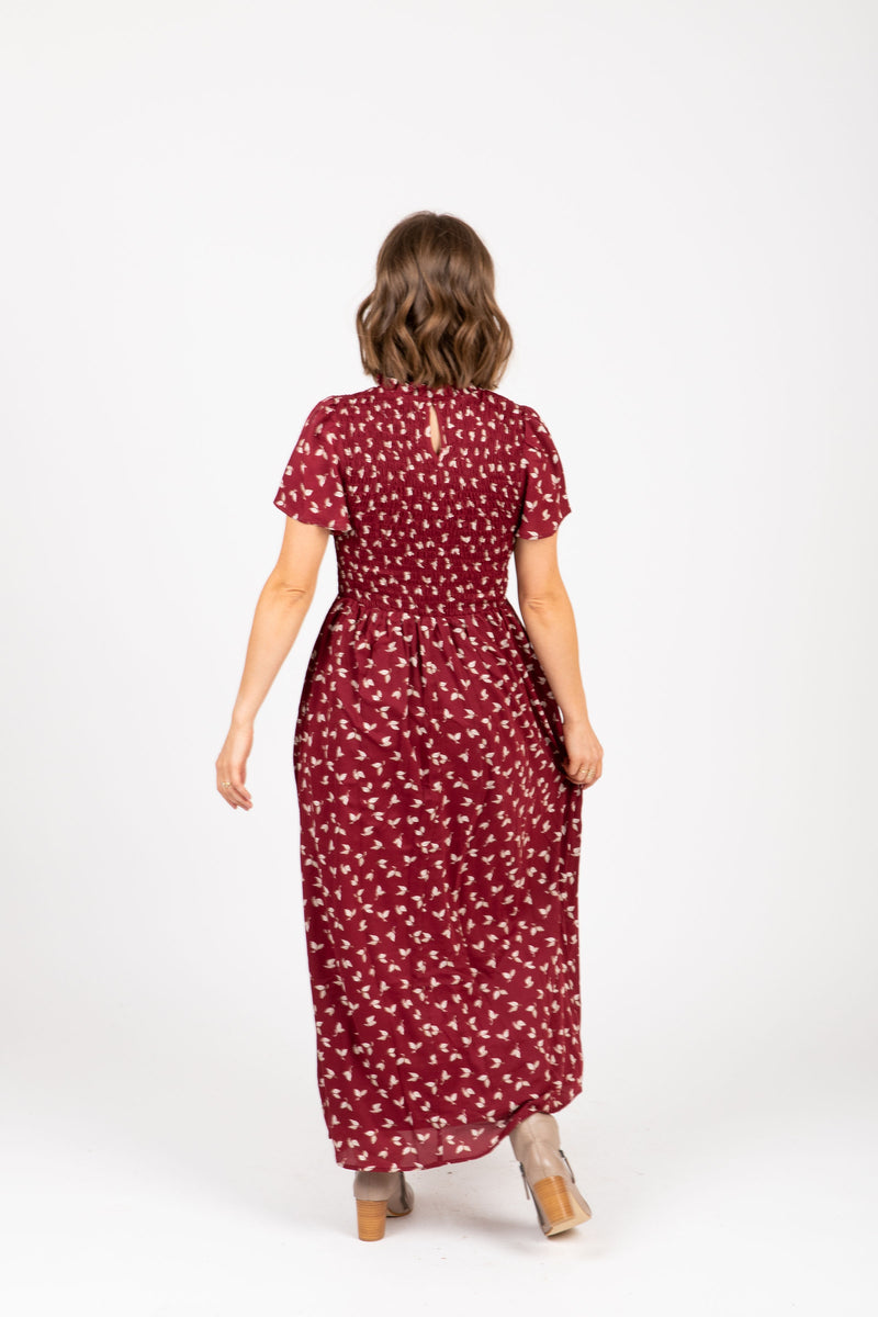 The Gibson Floral Smocked Dress in Burgundy, studio shoot; back view