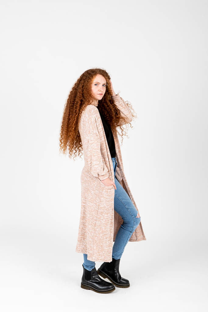 The Luna Duster Cardigan in Oatmeal, studio shoot; side view