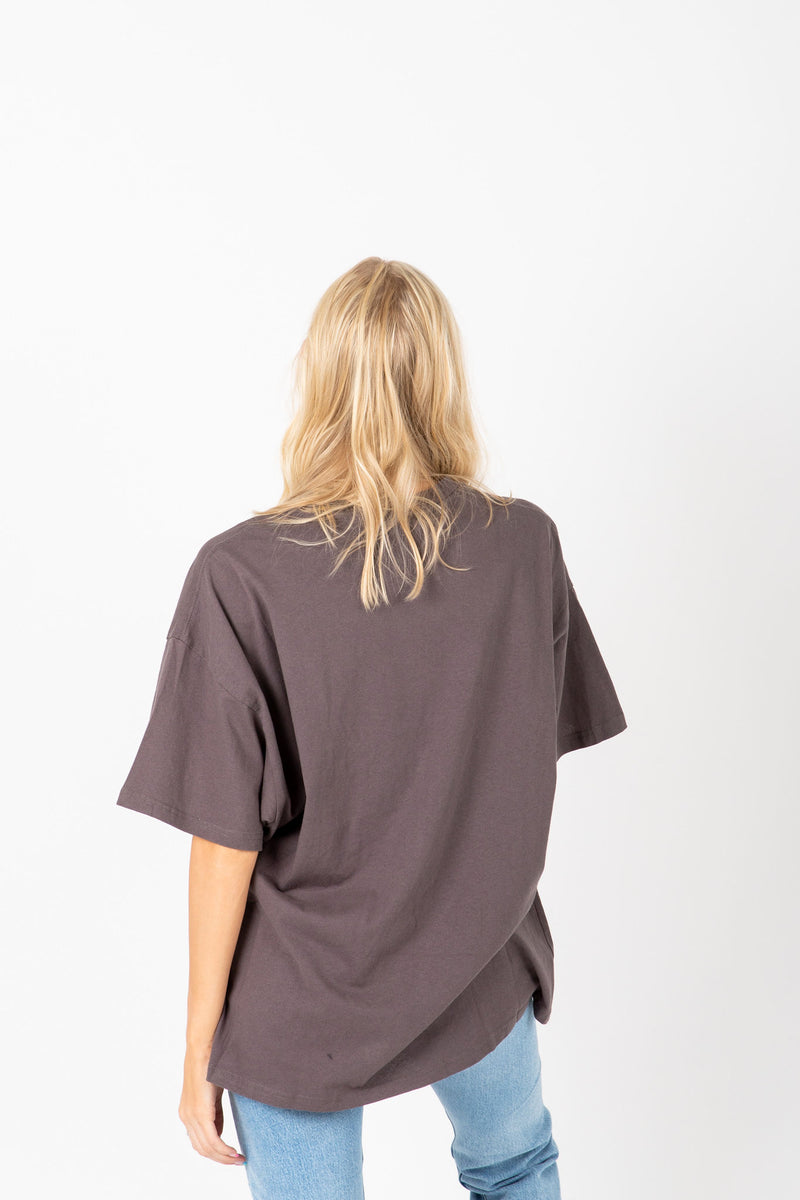 The Fae Distressed Girlfriend Tee in Charcoal, studio shoot; back view