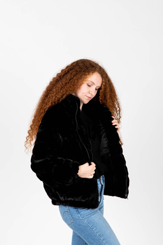 The Melling Faux Fur Jacket in Black, studio shoot; side view