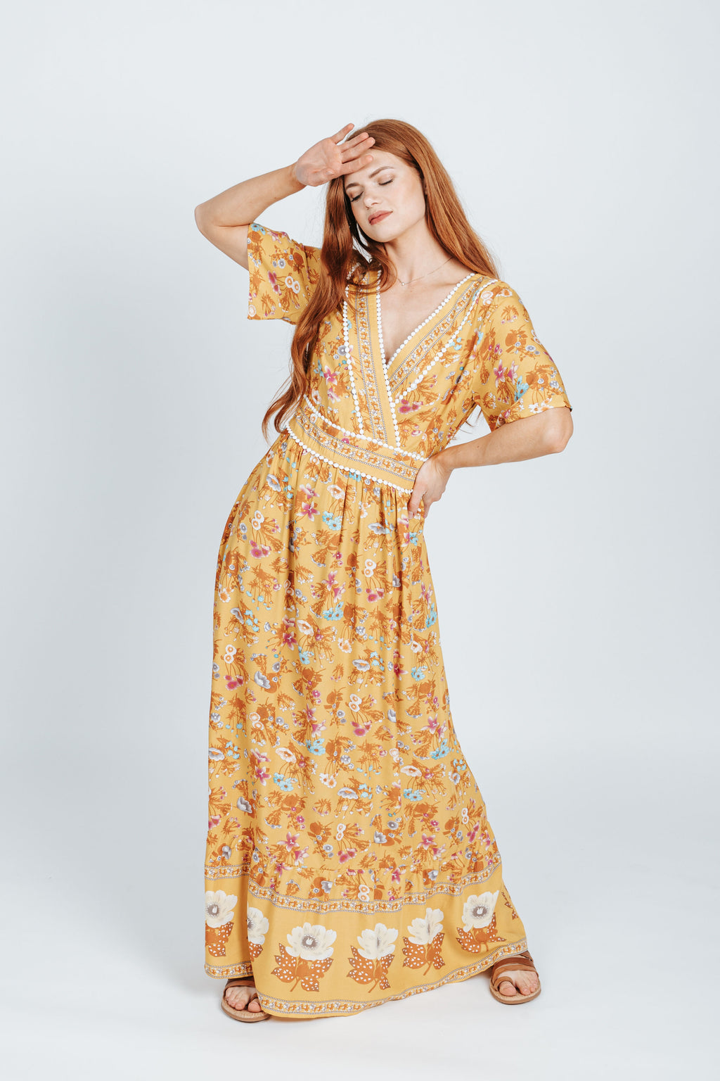 The Rico V-Neck Patterned Maxi Dress in Mustard, studio shoot; front view