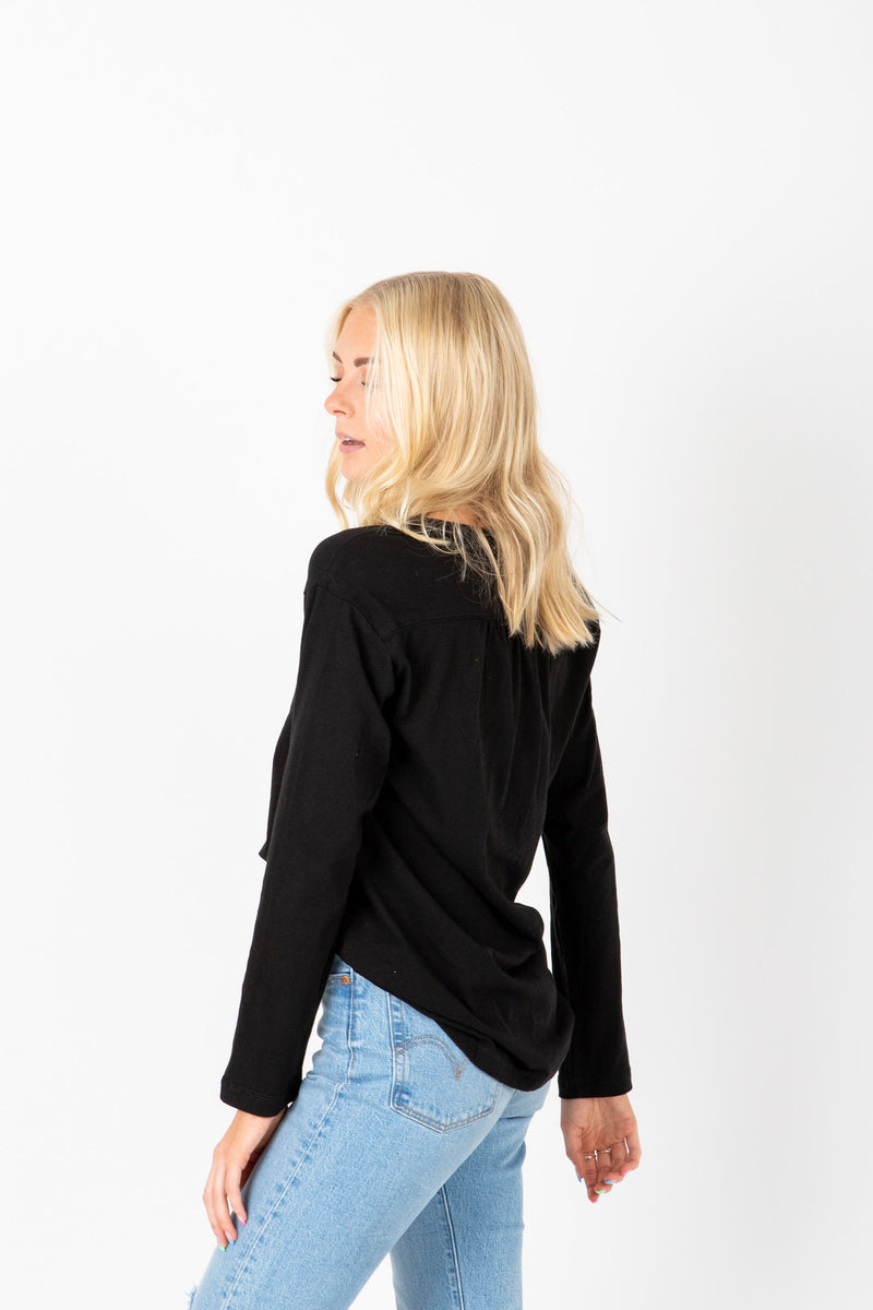 The Adam Snap Empire Blouse in Black, studio shoot; side view