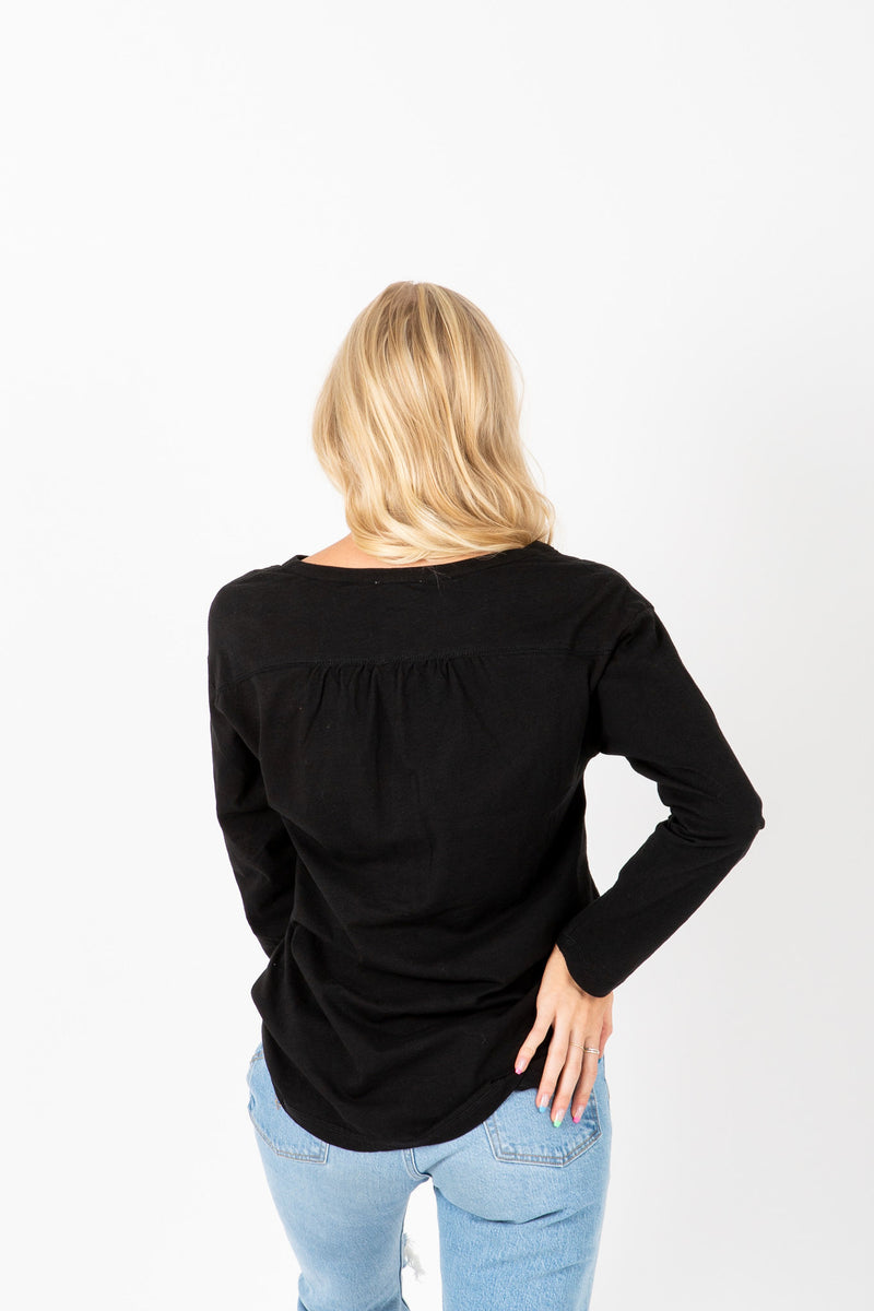 The Adam Snap Empire Blouse in Black, studio shoot; back view