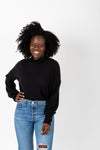 The Elmarie Cozy Mock Neck Blouse in Black, studio shoot; front view