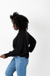The Elmarie Cozy Mock Neck Blouse in Black, studio shoot; side view