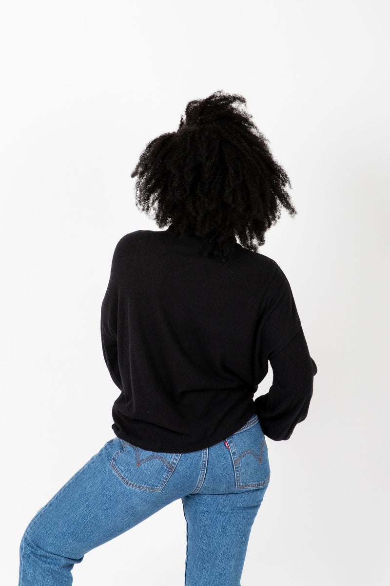 The Elmarie Cozy Mock Neck Blouse in Black, studio shoot; back view