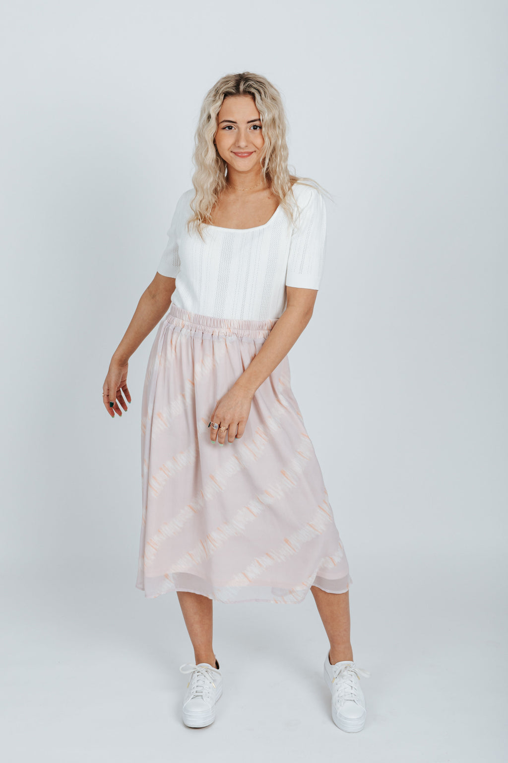 The Handley Watercolor Skirt in Dusty Pink, studio shoot; front view