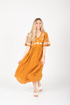The Cadence Embroidered Detail Dress in Golden, studio shoot; front view