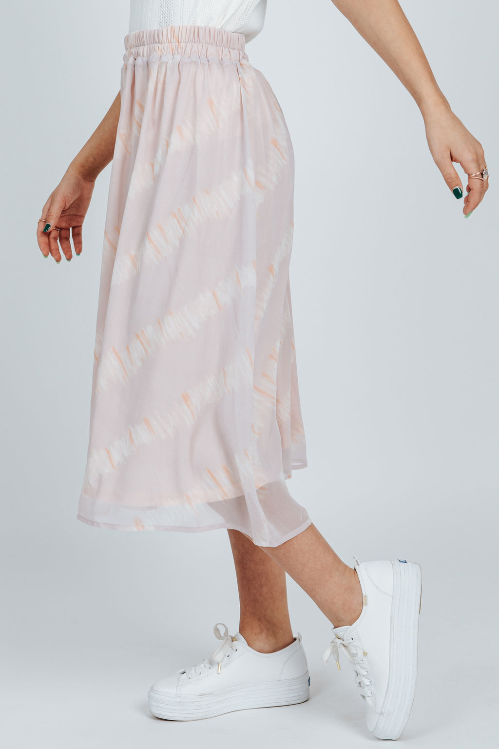 The Handley Watercolor Skirt in Dusty Pink, studio shoot; side view
