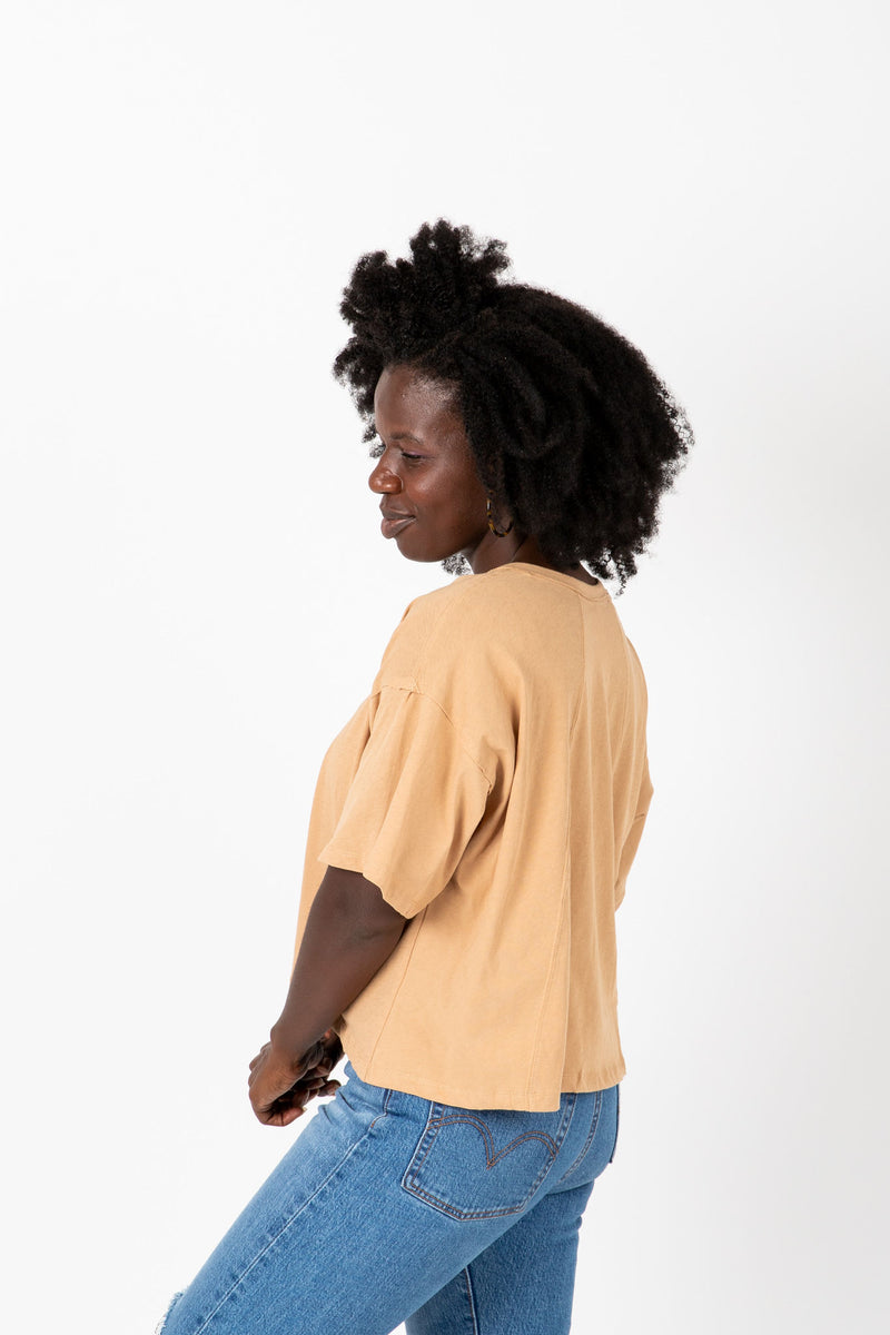 The Jay Button Tee in Taupe, studio shoot; side view
