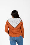 The Collins Sherpa Hooded Anorak Jacket in Rust, studio shoot; back view