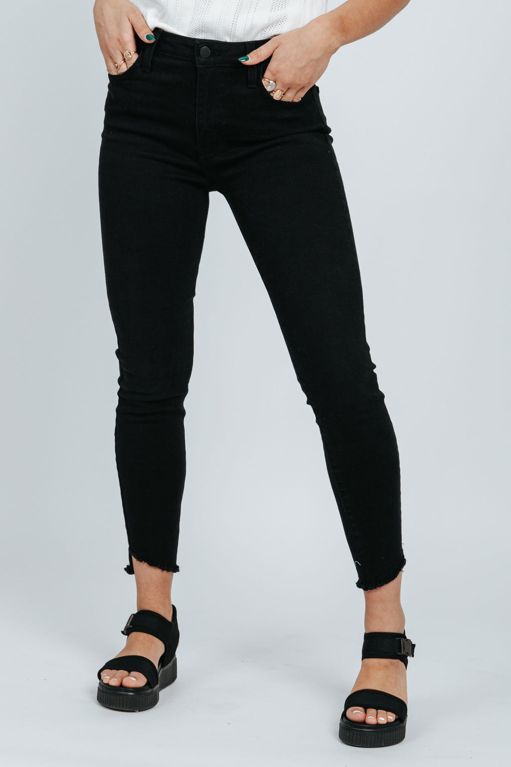 Letter To Juliet: The Verona Slant Hem Skinny Jean in Washed Black, studio shoot; front view