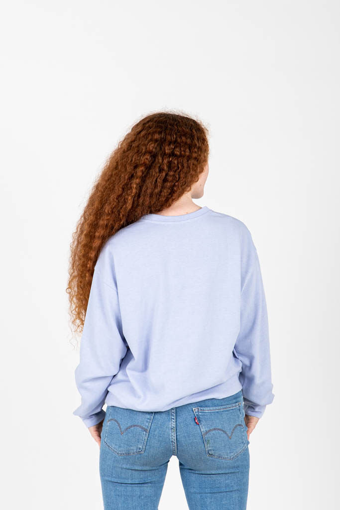 The Tom Cozy Crewneck in Sky, studio shoot; back view