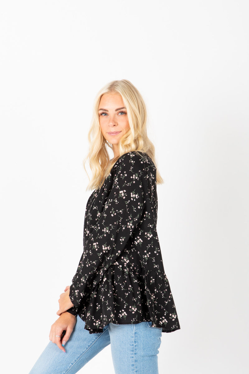 The Fey Floral Button Blouse in Black, lifestyle shoot; side view