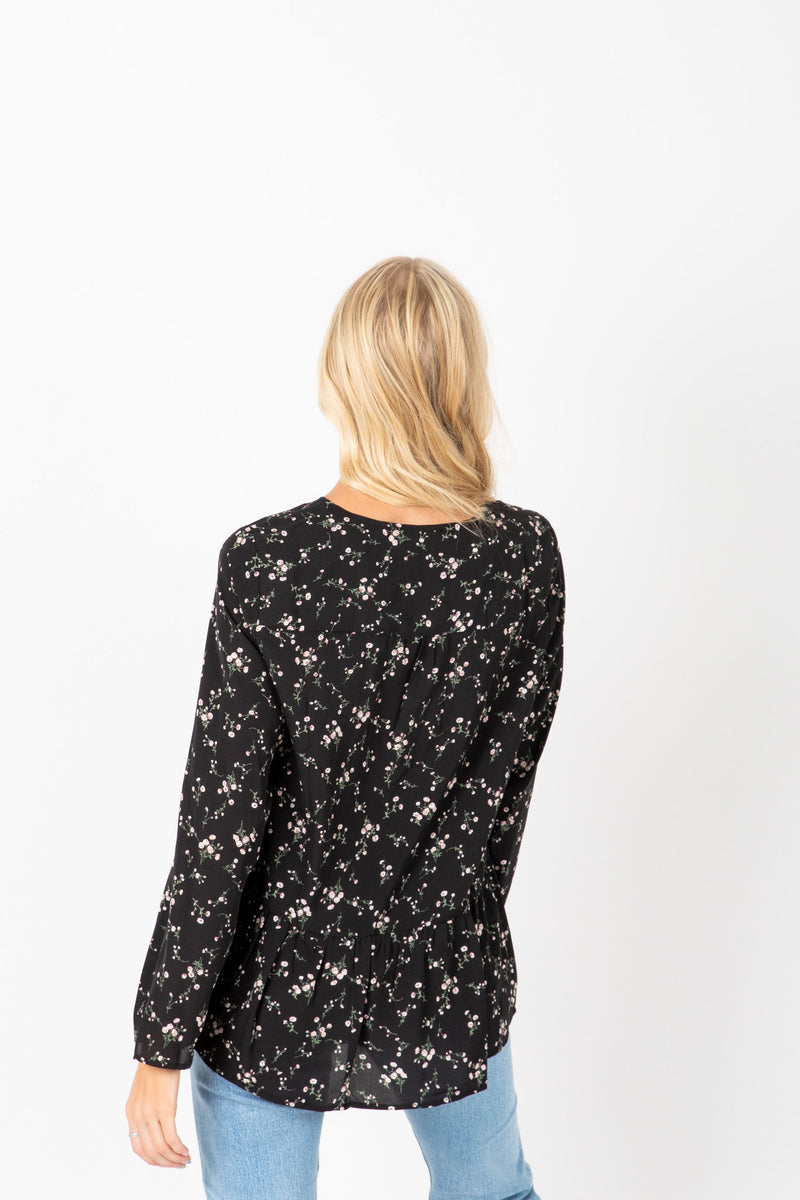 The Fey Floral Button Blouse in Black, lifestyle shoot; back view