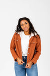 The Collins Sherpa Hooded Anorak Jacket in Rust, studio shoot; front view